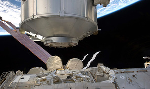 The Permanent Multipurpose Module in the grasp of Canadarm2.の写真素材 [FYI02942251]