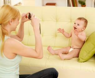 Mother Photographing Baby Boyの写真素材 [FYI02942376]