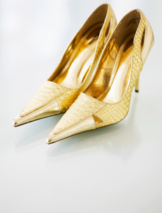 Pair of Golden High-Heeled Shoesの写真素材 [FYI02942431]
