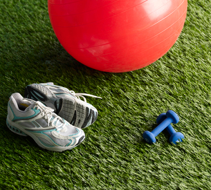Sneakers, Dumbbells and Exercise Ballの写真素材 [FYI02942436]