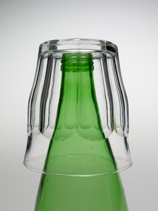 Close-Up of Glass Over Green Bottleの写真素材 [FYI02942440]
