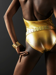 Woman Wearing Golden Swimming Costumeの写真素材 [FYI02942492]