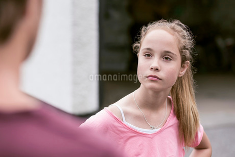 Angry girl looking at father outdoorsの写真素材 [FYI02943142]