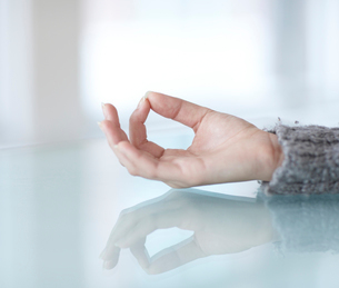 Woman's Hand in Lotus Positionの写真素材 [FYI02943150]