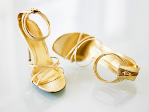 Pair of Golden High-Heeled Shoesの写真素材 [FYI02943359]