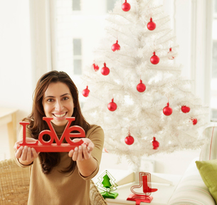 Woman Holding Christmas Decorationの写真素材 [FYI02943526]