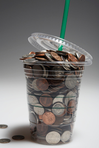 Coins in Disposable Cupの写真素材 [FYI02943608]