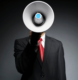Businessman Holding Bullhornの写真素材 [FYI02943871]