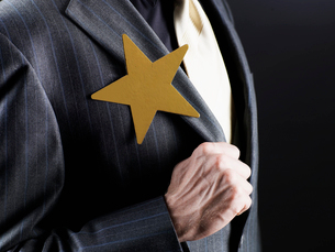 Star Shaped Brooch on man's Jacketの写真素材 [FYI02943909]