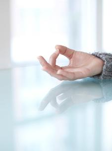 Woman's Hand in Lotus Positionの写真素材 [FYI02943922]