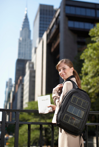 Businesswoman with Solar Panelled Backpackの写真素材 [FYI02944057]