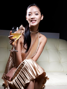 Mid-Adult Woman in Evening Dress Drinking White Wineの写真素材 [FYI02944165]
