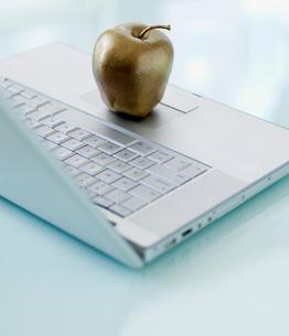 Decorative Apple on Laptopの写真素材 [FYI02944243]