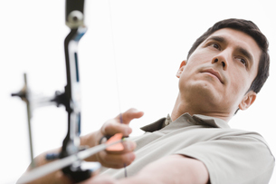 Man with bow and arrow (low angle view)の写真素材 [FYI02944349]