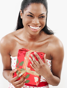 Woman Holding Christmas Presentの写真素材 [FYI02944523]