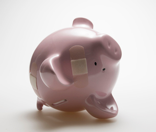 Piggy Bank with Plasters Upside Downの写真素材 [FYI02944560]