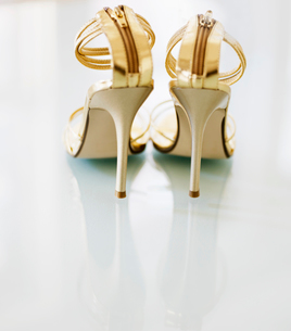 Pair of Golden High-Heeled Shoesの写真素材 [FYI02944678]