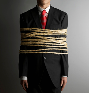 Businessman Tied with Ropeの写真素材 [FYI02945193]