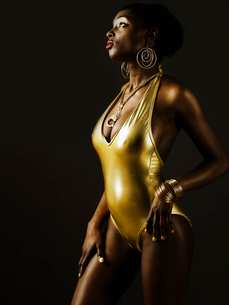 Young Woman in Golden Swimming Costumeの写真素材 [FYI02945566]