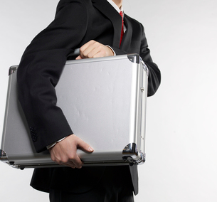 Businessman Carrying Briefcaseの写真素材 [FYI02945777]