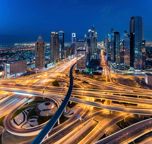 Cityscape of Dubai, United Arab Emirates at dusk, with skyscrapers and illuminated highways in the fの写真素材 [FYI02946141]
