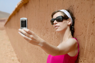Woman Picture Messaging by Wallの写真素材 [FYI02946610]