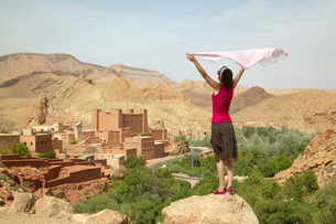Woman Holding Up Scarf near Ruinsの写真素材 [FYI02946923]