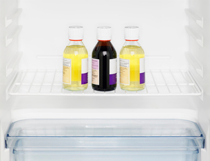 Three medicine bottles in fridgeの写真素材 [FYI02954104]