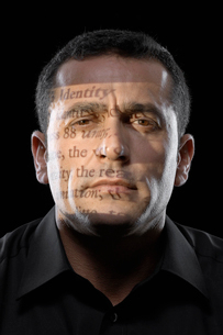 Text projected on mans faceの写真素材 [FYI02960274]