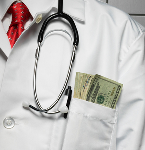 Doctor with Money in Pocketの写真素材 [FYI02960561]