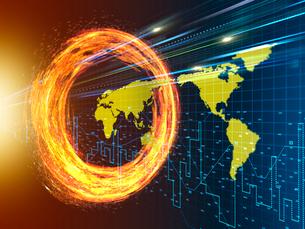 旋回する炎の輪を突き抜ける光線と世界地図の写真素材 [FYI03057633]