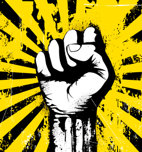 Vector illustration of clenched fist held high in protest on the yellow grunge urban backgroundのイラスト素材 [FYI03072472]