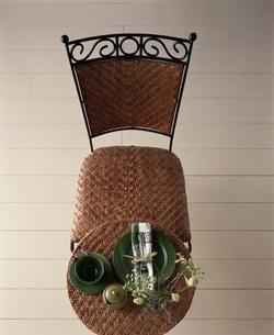 籐の椅子とテーブルの上にティーセットと花の写真素材 [FYI03170357]