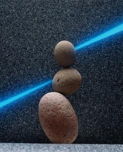 石と青い光線の写真素材 [FYI03180302]