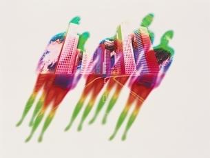 高層ビル群と虹色の人イメージの合成 CGの写真素材 [FYI03203075]