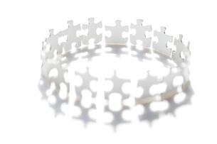 白いパズルでつくられた円の写真素材 [FYI03361922]