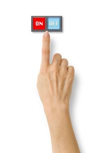 オンオフスイッチと右手の写真素材 [FYI03361951]