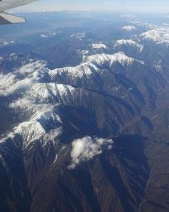 南アルプスこと赤石山脈を飛行機から一望の写真素材 [FYI03404598]