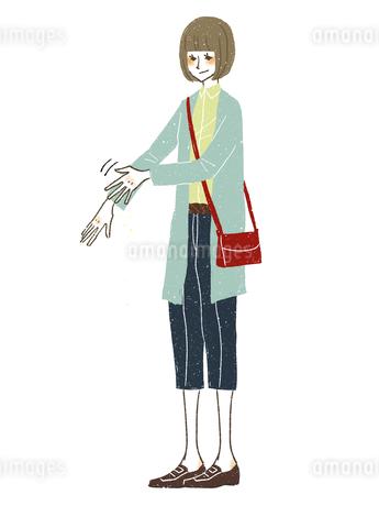 女性-衣服の花粉や埃をはらい落とすのイラスト素材 [FYI03408267]