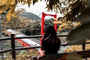 girl with red bridgeの写真素材 [FYI03420630]