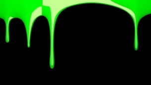 Green liquid on black backgroundのイラスト素材 [FYI03423984]
