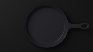 Cast iron skillet on black backgroundのイラスト素材 [FYI03424667]