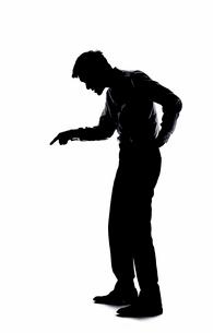 指をさし説教する上司の影の写真素材 [FYI03428123]