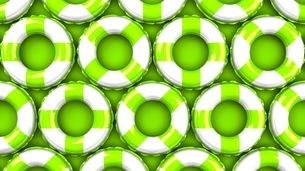 Green swim rings on green backgroundのイラスト素材 [FYI03437516]