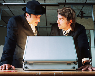 Gangsters with briefcaseの写真素材 [FYI03459920]