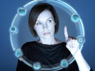 Woman and computer symbolsの写真素材 [FYI03463547]
