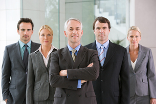 Five businesspeople in a rowの写真素材 [FYI03464793]