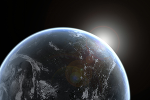 Sun emerging over planet earthの写真素材 [FYI03465702]