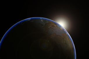 Sun emerging over planet earthの写真素材 [FYI03465707]