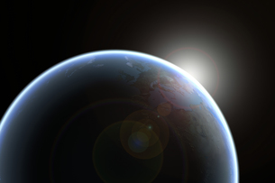 Sun emerging over planet earthの写真素材 [FYI03465725]
